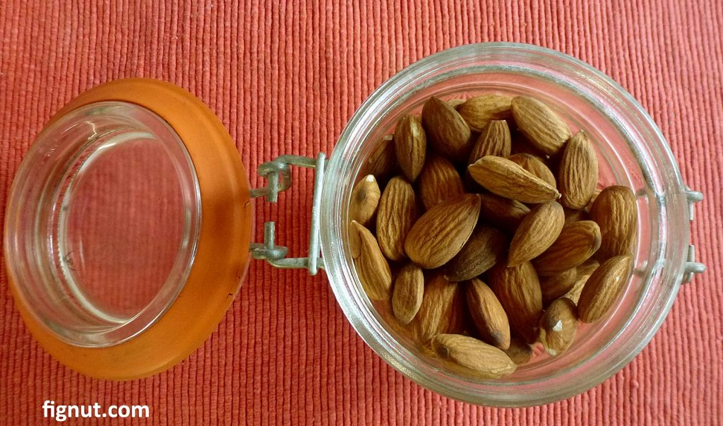 Nuts stored in the see-through mason jar