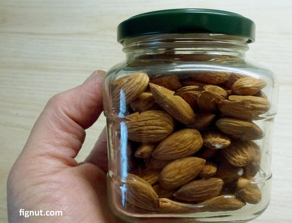 Unshelled almond nuts stored in the airtight container