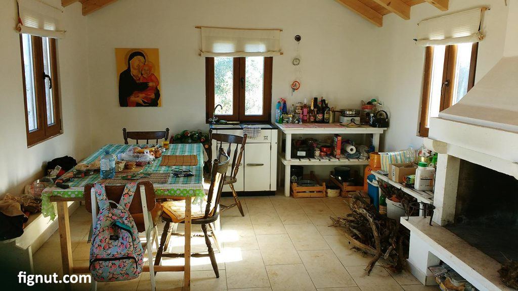 The interior of the cottage - kitchen, dining and fireplace